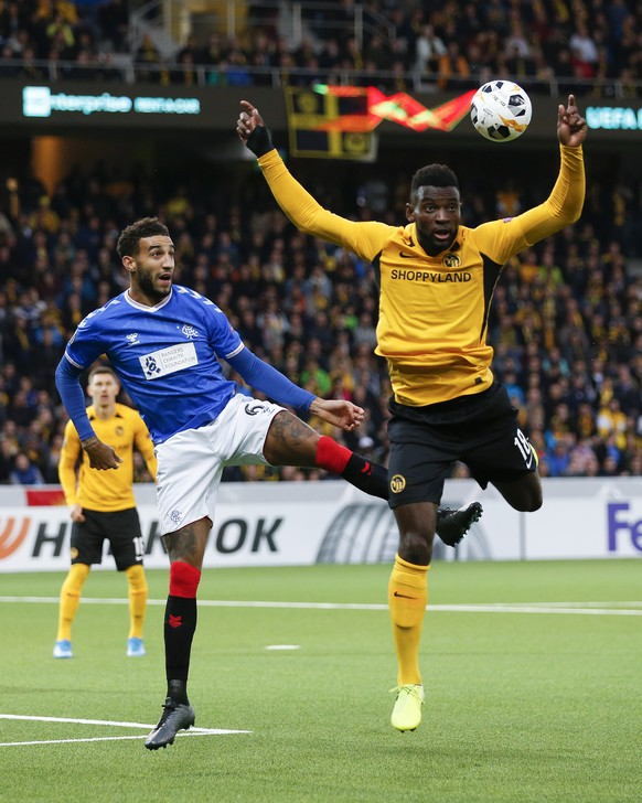 Glasgow's Connor Goldson, left, and Young Boys' Jean-Pierre Nsame in action, during the UEFA Europa League group stage match between Switzerland's BSC Young Boys Bern and Scotland's Glasgow Rangers, at the Stade de Suisse Stadium in Bern, Switzerland, Thursday, October 3, 2019. (KEYSTONE/Peter Klaunzer)