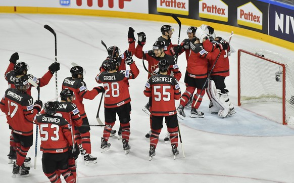 Canada's players celebrate their 4-2 victory at the Ice Hockey World Championships semifinal match between Canada and Russia in the LANXESS arena in Cologne, Germany, Saturday, May 20, 2017. (AP Photo/Martin Meissner)