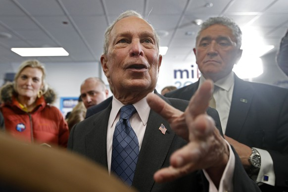 Democratic presidential candidate and former New York City Mayor Michael Bloomberg, center, greets supporters at a campaign office, Monday, Jan. 27, 2020, in Scarborough, Maine. (AP Photo/Robert F. Bukaty) Michael Bloomberg