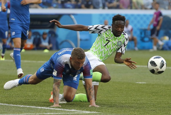 epa06831184 Ragnar Sigurdsson (L) of Iceland and Ahmed Musa of Nigeria in action during the FIFA World Cup 2018 group D preliminary round soccer match between Nigeria and Iceland in Volgograd, Russia, 22 June 2018.  (RESTRICTIONS APPLY: Editorial Use Only, not used in association with any commercial entity - Images must not be used in any form of alert service or push service of any kind including via mobile alert services, downloads to mobile devices or MMS messaging - Images must appear as still images and must not emulate match action video footage - No alteration is made to, and no text or image is superimposed over, any published image which: (a) intentionally obscures or removes a sponsor identification image; or (b) adds or overlays the commercial identification of any third party which is not officially associated with the FIFA World Cup)  EPA/SERGEI ILNITSKY   EDITORIAL USE ONLY