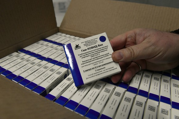 Boxes of Sputnik V vaccines at a warehouse of Hungaropharma, a Hungarian pharmaceutical wholesale company, in Budapest, Hungary, Thursday, March 4, 2021, after a shipment of 280,000 doses of the Russian vaccine Sputnik V arrived in Hungary. (Zoltan Mathe/MTI via AP)
