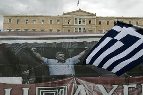 Supporters of the Golden Dawn ultra nationalist party  hold  a banner depicting its leader, Nikolaos Michaloliakos while gathering  in front of the Greek parliament in Athens on June 4, 2014.  Around 400 Golden Dawn supporters  gathered in Athens  early  on  Wednesday outside parliament, which must make a decision on lifting immunity for the leader of the extreme right party, according to a police source.Nikolaos Michaloliakos has been in provisional detention since September for belonging