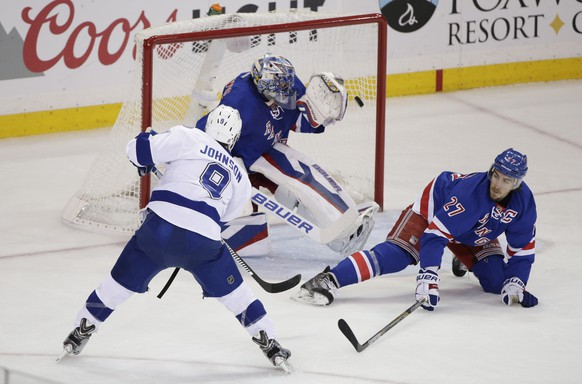 Tampa Bay Lightning center Tyler Johnson (9) shoots to score his second goal of the game against New York Rangers goalie Henrik Lundqvist (30) during the first period of Game 2 of the Eastern Conference final during the NHL hockey Stanley Cup playoffs, Monday, May 18, 2015, in New York. (AP Photo/Frank Franklin II)