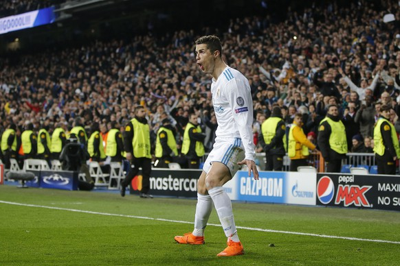 Real Madrid's Cristiano Ronaldo celebrates his side's 2nd goal during the Champions League soccer match, round of 16, 1st leg between Real Madrid and Paris Saint Germain at the Santiago Bernabeu stadium in Madrid, Spain, Wednesday, Feb. 14, 2018. (AP Photo/Paul White)