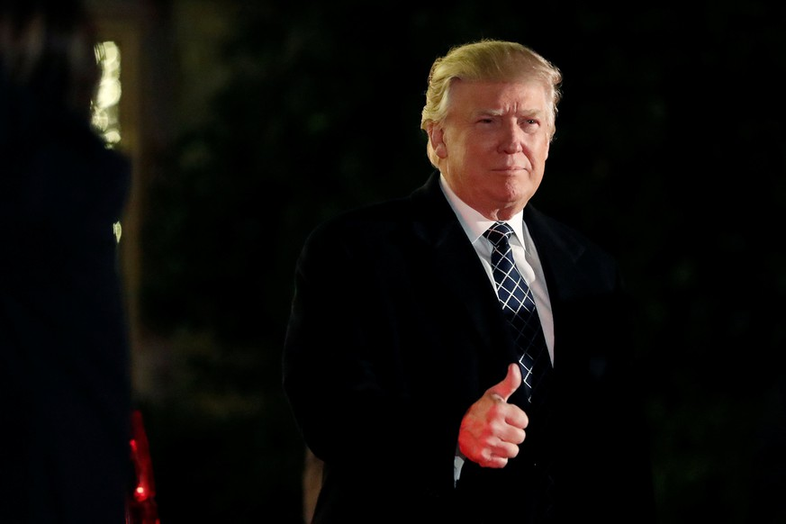 U.S. President-elect Donald Trump gives a thumbs up to the media as he arrives at a costume party at the home of hedge fund billionaire and campaign donor Robert Mercer in Head of the Harbor, New York, U.S., December 3, 2016. REUTERS/Mark Kauzlarich/File Photo