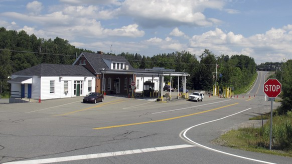 This Aug. 2, 2017 photo shows the U.S. border crossing post at the Canadian border between Vermont and Quebec, Canada, in Norton, Vt. U.S. Customs and Border Protection is offering financial incentives for people willing to work at 21 remote, hard-to-fill border crossings across the country, including Norton. (AP Photo/Wilson Ring)