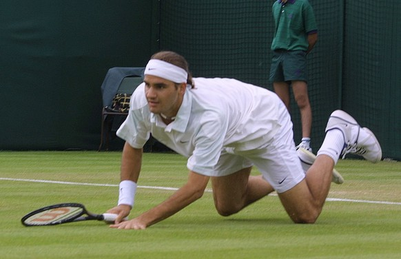 Switzerland's Roger Federer takes a fall during his match  against  Xavier Malisse of Belgium in their  second round men's  singles match at Wimbledon, Wednesday June 27, 2001.  (KEYSTONE/AP Photo/Alastair Grant)