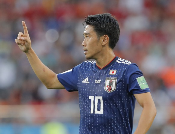 Japan's Shinji Kagawa gestures during the group H match between Japan and Senegal at the 2018 soccer World Cup at the Yekaterinburg Arena in Yekaterinburg , Russia, Sunday, June 24, 2018. (AP Photo/Vadim Ghirda)