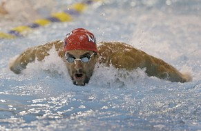 Michael Phelps warms up before the upcoming Charlotte Grand Prix swimming event in Charlotte, N.C., Thursday, May 15, 2014. (AP Photo/Chuck Burton)