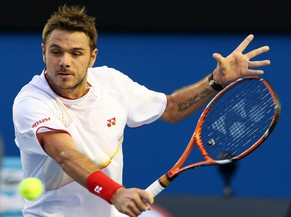 epa04034540 Stanislas Wawrinka of Switzerland returns the ball to Novak Djokovic of Serbia during his quarter final match at the Australian Open Grand Slam tennis tournament in Melbourne, Australia, 21 January 2014. Wawrinka won the match in five sets.  EPA/DAVID CROSLING AUSTRALIA AND NEW ZEALAND OUT