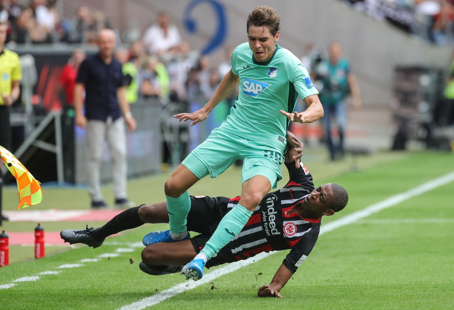 epa07779398 Frankfurt's Gelson Fernandes (down) in action against Hoffenheim's Robert Skov  during the German Bundesliga soccer match between Eintracht Frankfurt and TSG Hoffenheim in Frankfurt Main, Germany, 18 August 2019.  EPA/ARMANDO BABANI CONDITIONS - ATTENTION: The DFL regulations prohibit any use of photographs as image sequences and/or quasi-video
