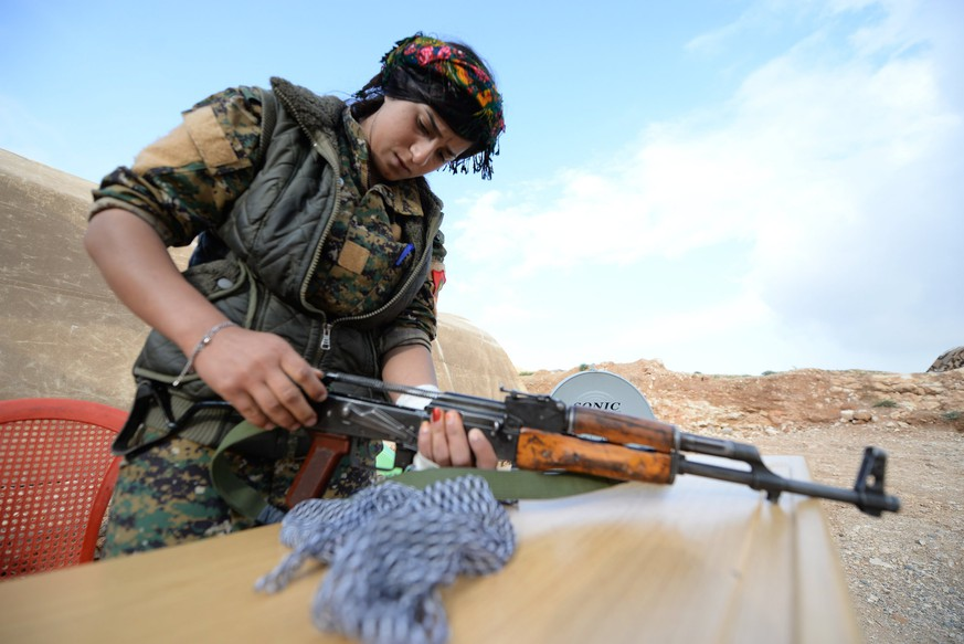 epa06664470 A member of the Women's Protection Units (YPJ) cleans her weapon at a military barracks near the northern Iraqi town of Sinjar, Iraq, 11 April 2018 (issued on 12 April 2018). Hundreds of Kurdish women, including Yazidis from Syria and Iraq have taken part in the fighting against Islamic state group (IS), and control the borders areas in Syria and neighboring Iraq to protect their community from suspected attacks by (IS) members. The group is the female counterpart to the Kurdish People's Protection Units (YPG), the armed branch of the leading Kurdish Democratic Union Party (PYD) and key component of the US-backed Kurdish-Arab 'Syria democratic forces' (SDF).  EPA/MURTAJA LATEEF