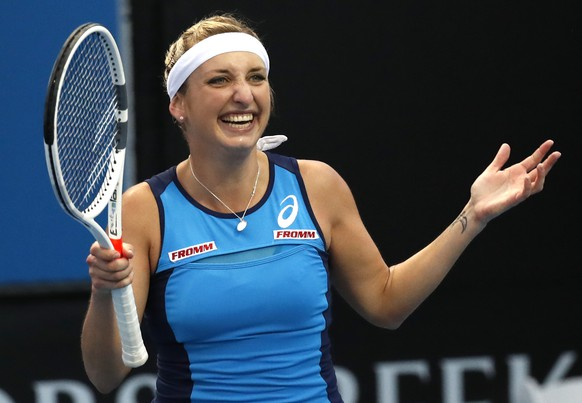 Switzerland's Timea Bacsinszky celebrates after defeating Italy's Camila Giorgi during their first round match at the Australian Open tennis championships in Melbourne, Australia, Tuesday, Jan. 17, 2017. (AP Photo/Kin Cheung)