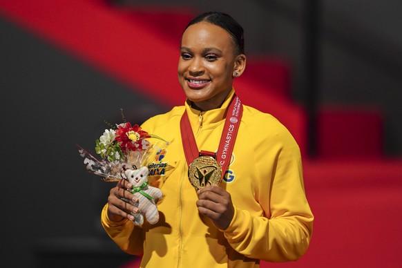 epa09540678 Gold medalist Rebeca Andrade of Brazil celebrate after winning in the Women's Vault Final at the 50th FIG Artistic Gymnastics World Championships in Kitakyushu, Japan, 23 October 2021.  EPA/KIMIMASA MAYAMA