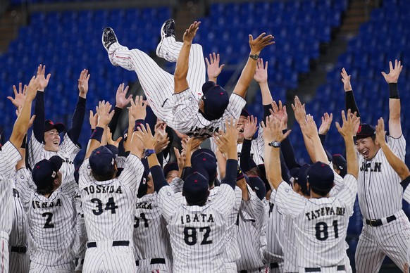 Team Japan celebrate with their manager Atsunori Inaba after the gold medal baseball game against the United States at the 2020 Summer Olympics, Saturday, Aug. 7, 2021, in Yokohama, Japan. Japan won 2-0. (AP Photo/Sue Ogrocki)