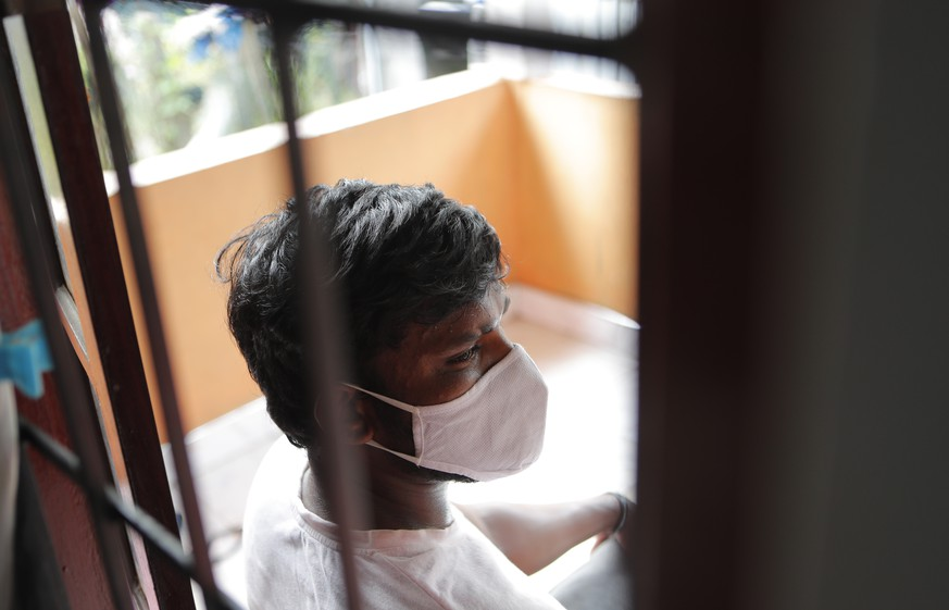 Sri Lankan auto rickshaw driver Prasad Dinesh, linked by Sri Lankan officials to nearly half the country's more than 2,600 coronavirus cases, sits in his house in Ja-Ela, Sri Lanka, Wednesday, July 1, 2020. For months he