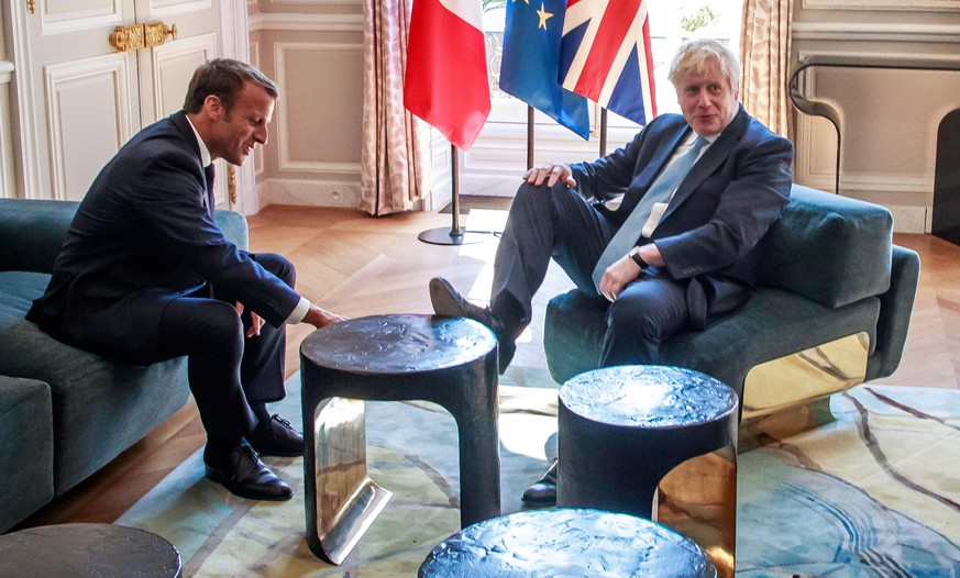 epa07786190 French President Emmanuel Macron (L) and British Prime Minister Boris Johnson (R) during their meeting at the Elysee Palace in Paris, France, 22 August 2019. Johnson is in Paris after a one day visit in Berlin.  EPA/CHRISTOPHE PETIT TESSON / POOL