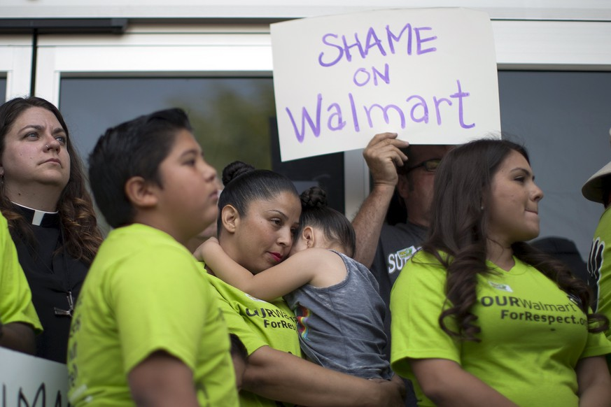 Laid-off Walmart employees and supporters hold a news conference outside the Pico Rivera Walmart Store, which was recently closed on very short notice, in Los Angeles, California, April 20, 2015. The former employees dispute the claim they say was given by Walmart that the store was closed because of plumbing problems, and want to be given jobs in other stores. A union on Monday asked the National Labor Relations Board to force Wal-Mart to reinstate employees at five stores, accusing the retailer of closing the locations to retaliate against workers for attempts to organize for better pay and benefits. Wal-Mart Stores, which announced last week that it was temporarily closing five stores in Texas, Oklahoma, Florida and California to fix plumbing issues, denied the union's claims. It said it would work to reopen the stores, which employed about 2,200 people, as quickly as possible. REUTERS/David McNew      TPX IMAGES OF THE DAY
