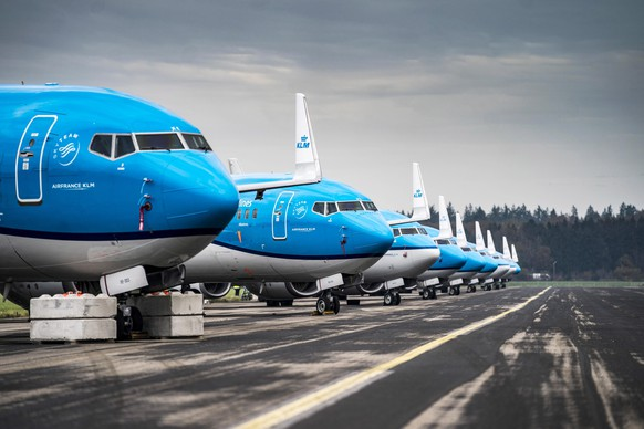 epa08809864 Twelve KLM passenger planes are grounded for the winter at Groningen Airport Eelde, the Netherlands, 09 November 2020.  EPA/SIESE VEENSTRA
