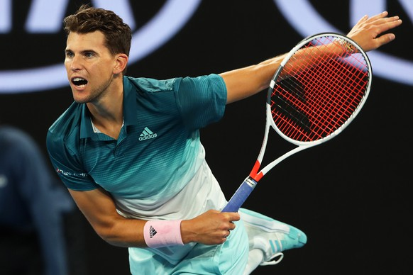 epa07292047 Dominic Thiem of Austria in action against Alexei Popyrin of Australia during their men's second round match of the Australian Open Grand Slam tennis tournament in Melbourne, Australia, 17 January 2019.  EPA/DAVID CROSLING AUSTRALIA AND NEW ZEALAND OUT