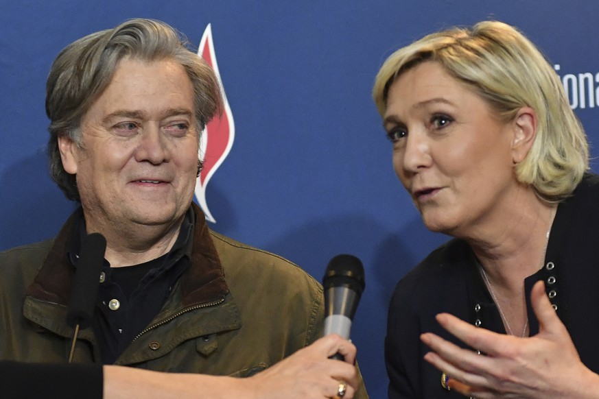 National Front party leader Marine Le Pen, right, and former White House strategist Steve Bannon hold a press conference at the party congress in the northern French city of Lille, Saturday, March 10, 2018. Steve Bannon has given a big boost to French far right leader Marine Le Pen, telling a cheering crowd at a congress of her National Front party that