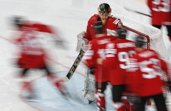 Switzerland's Leonardo Genoni greets his teammates prior the Ice Hockey World Championships group B match between Switzerland and France in the AccorHotels Arena in Paris, France, Tuesday, May 9, 2017. (AP Photo/Petr David Josek)