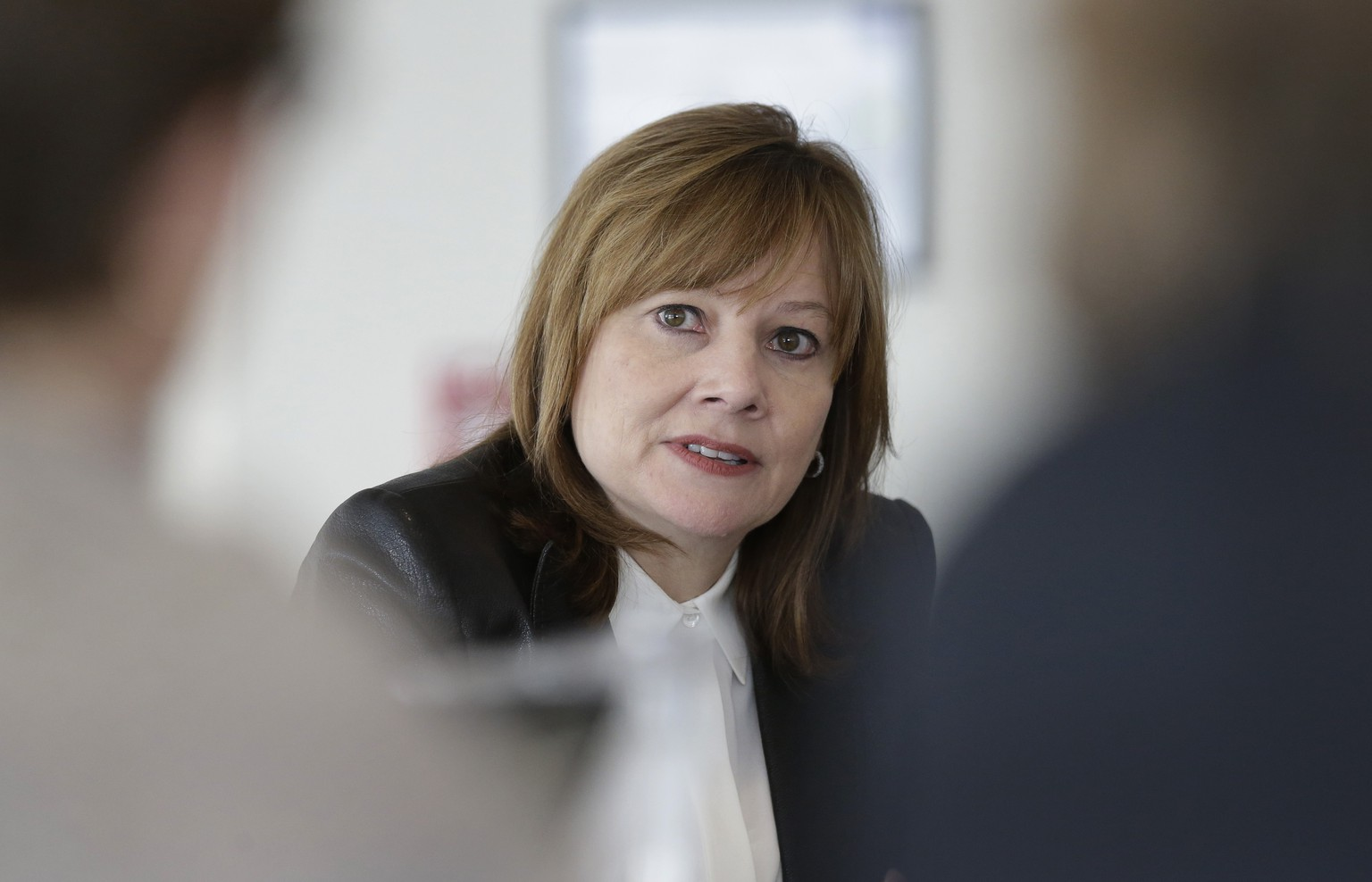 File-This photo taken Jan. 23, 2014, shows General Motors CEO Mary Barra addressing the media during a roundtable meeting with journalists in Detroit. Barra will be asked by two Congressional subcommittees why it took GM a decade to recall cars with faulty ignition switches that the company says are now linked to 13 deaths. (AP Photo/Carlos Osorio, File)
