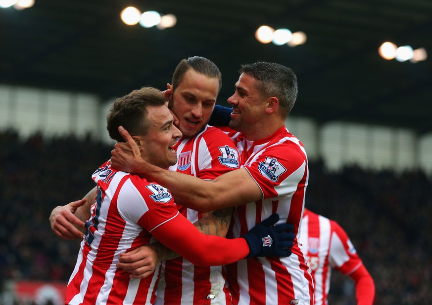 STOKE ON TRENT, ENGLAND - FEBRUARY 27:  Marko Arnautovic (C) of Stoke City celebrates scoring his team's second goal with his team mates Xherdan Shaqiri (L) and Jonathan Walters (R) during the Barclays Premier League match between Stoke City and Aston Villa at Britannia Stadium on February 27, 2016 in Stoke on Trent, England.  (Photo by Dave Thompson/Getty Images)