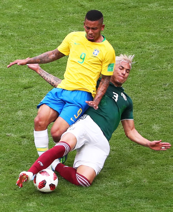 epa06858017 Gabriel Jesus (L) of Brazil in action against Carlos Salcedo (R) of Mexico during the FIFA World Cup 2018 round of 16 soccer match between Brazil and Mexico in Samara, Russia, 02 July 2018.  (RESTRICTIONS APPLY: Editorial Use Only, not used in association with any commercial entity - Images must not be used in any form of alert service or push service of any kind including via mobile alert services, downloads to mobile devices or MMS messaging - Images must appear as still images and must not emulate match action video footage - No alteration is made to, and no text or image is superimposed over, any published image which: (a) intentionally obscures or removes a sponsor identification image; or (b) adds or overlays the commercial identification of any third party which is not officially associated with the FIFA World Cup)  EPA/TATYANA ZENKOVICH   EDITORIAL USE ONLY
