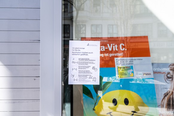 epa08295958 A warning sign reading 'Wir sind immer für Sie da. Apotheken bleiben auch weiterhin geoeffnet.' (lit.: We are always here for you. Pharmacies will remain open.) is seen on a pharmacy window in Vienna, Austria, 15 March 2020. Austrian Chancellor Kurz earlier in the day announced an extended restrictions of movement from 16 March 2020 on. Several European countries have closed borders, schools as well as public facilities, and have cancelled most major sports and entertainment events in order to prevent the spread of the SARS-CoV-2 coronavirus causing the Covid-19 disease.  EPA/SUSANNE HASSLER-SMITH