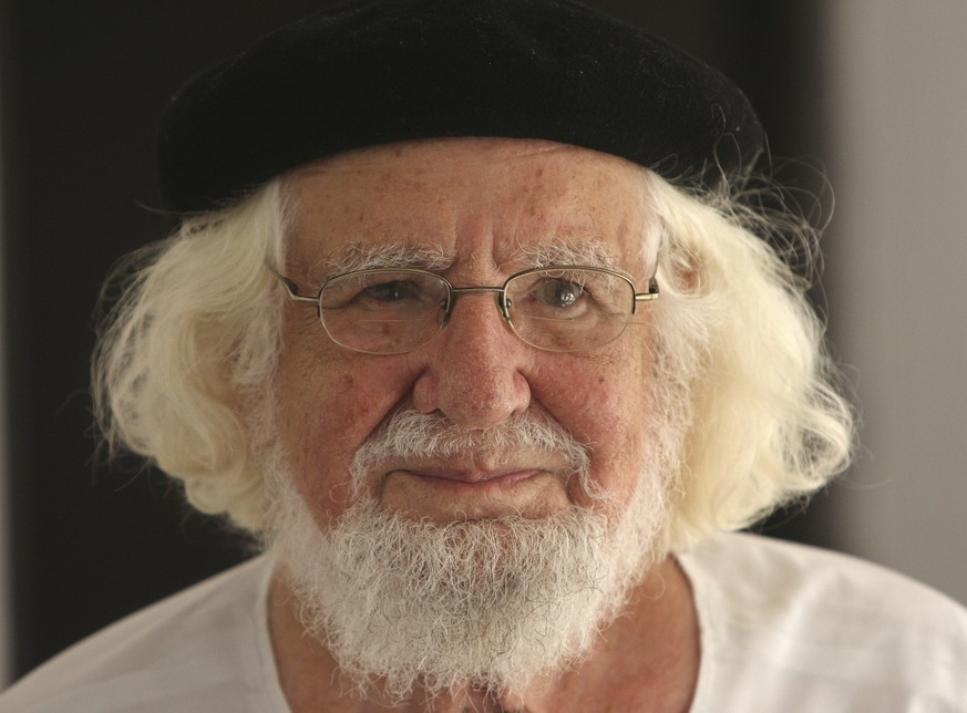 FILE - This Aug. 29, 2008 file photo shows Nicaraguan priest and poet Ernesto Cardenal in his home while under house arrest, in Managua, Nicaragua. Cardenal has died on March 1, 2020. (AP Photo/Esteban Felix, File) Ernesto Cardenal
