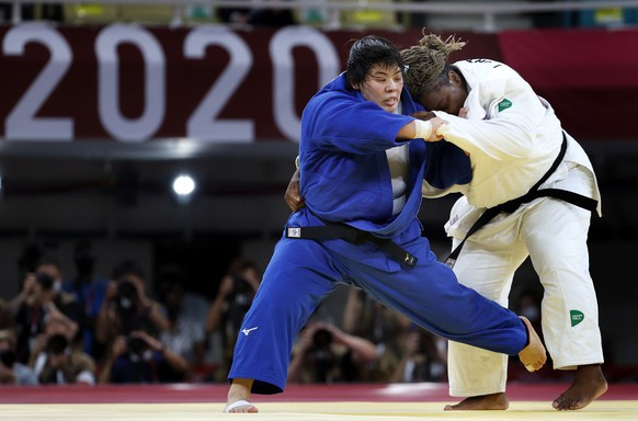 epa09379657 Gold medal winner Akira Sone of Japan (blue) in action against silver medal winner Idalys Ortiz of Cuba (white) during the Women +78 kg Final contest at the Judo events of the Tokyo 2020 Olympic Games at the Nippon Budokan arena in Tokyo, Japan, 30 July 2021.  EPA/RITCHIE B. TONGO
