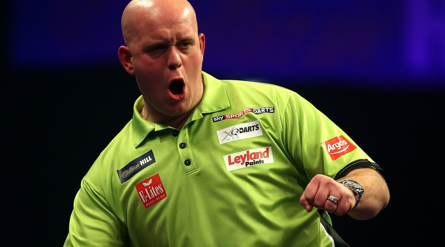 LONDON, ENGLAND - JANUARY 01: Michael van Gerwen of Holland celebrates winning his quarter final match against Robert Thornton of Scotland during the William Hill PDC World Darts Championships on Day Eleven at Alexandra Palace on January 01, 2015 in London, England. (Photo by Charlie Crowhurst/Getty Images)