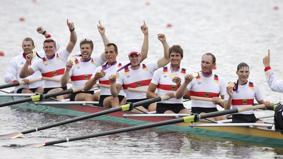 FILE - In this file photo dated Wednesday, Aug. 1, 2012, Germany's rowing eight crew, from right, Kristof Wilke, Florian Mennigen, Lukas Mueller, Richard Schmidt, Maximilian Reinelt, Eric Johannesen, Andreas Kuffner and Filip Adamski celebrate after winning the gold medal for the men's rowing eight at Eton Dorney, near Windsor, England, during the 2012 Summer Olympics. Maximilian Reinelt, seen 5th from left, a long-time part of Germany's successful men's eights crew, has died, aged 30, according to the Swiss canton police of Graubuenden who say Monday Feb. 11, 2019, that Reinelt collapsed while cross-country skiing in St. Moritz at the weekend.(AP Photo/Armando Franca, FILE)