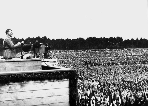 German Chancellor Adolf Hitler, emphasizing his points with clenched fists, is pictured addressing the gathering of his staff chiefs at the giant Nazi demonstration held on the Reichsparteitag area in Nuremberg, Germany, September 13, 1933.   (KEYSTONE/AP Photo/Str) ===  ===