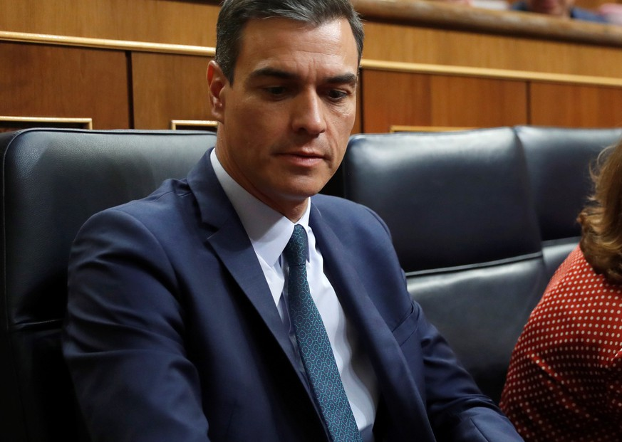 epa07739802 Spanish acting Prime Minister and aspirant for re-election Pedro Sanchez (L) and acting Deputy Prime Minister Carmen Calvo (R) attend the second and last investiture vote at the Lower Chamber of Spanish Parliament in Madrid, Spain, 25 July 2019. Sanchez faces his re-election vote at Lower Chamber without enough support from other parties, as the socialists have no reached an agreement with left coalition Unidas Podemos (United, We Can) yet.  EPA/Emilio Naranjo