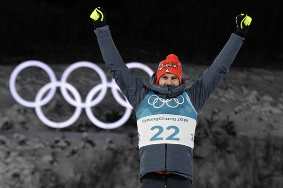 Arnd Peiffer, of Germany, celebrates his gold medal during the venue ceremony after the men's 10-kilometer biathlon sprint at the 2018 Winter Olympics in Pyeongchang, South Korea, Sunday, Feb. 11, 2018. (AP Photo/Gregorio Borgia)