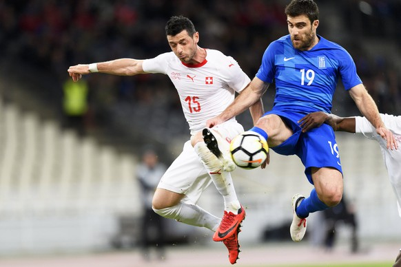 epa06624579 Switzerland's midfielder Blerim Dzemaili (L) in action against Greece's defender Sokratis Papastathopoulos (L) during the International Friendly soccer match between Greece and Switzerland at the Olympic stadium in Athens, Greece, 23 March 2018.  EPA/LAURENT GILLIERON