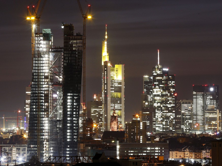 The new headquarters of the European Central Bank, left, is under construction in Frankfurt, Germany, Thursday, Oct. 18, 2012. The ECB will move into the building in 2014. (AP Photo/Michael Probst)