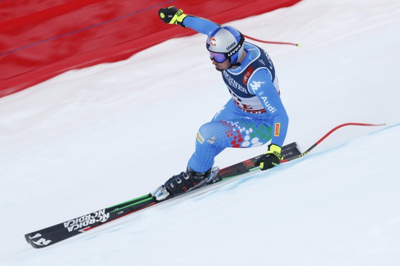 Italy's Dominik Paris speeds down the course during the downhill portion of the men's combined, at the alpine ski World Championships in Are, Sweden, Monday, Feb.11, 2019. (AP Photo/Gabriele Facciotti)