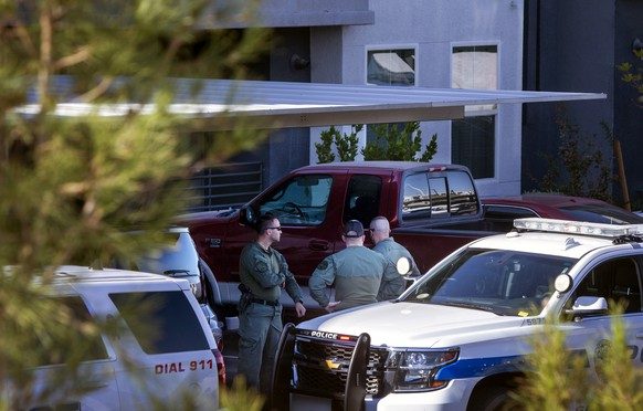 Henderson Police officers are shown at the scene of a fatal shooting in an apartment complex in Henderson, Nev. Tuesday, Nov. 3, 2020. Four people are dead including a possible suspect in the shooting, police said. (Steve Marcus/Las Vegas Sun via AP)