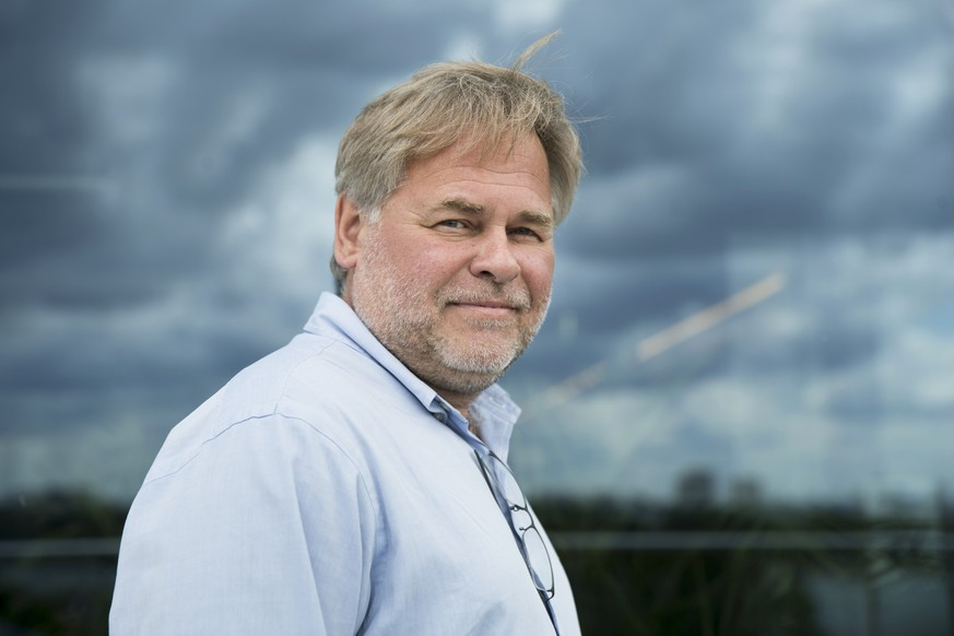 FILE - In this July 1, 2017, file photo, Eugene Kaspersky, Russian antivirus programs developer and chief executive of Russia's Kaspersky Lab, poses for a photo on a balcony at his company's headquarters in Moscow, Russia. On Sept. 13, the U.S. banned the use of computer software supplied by Kaspersky Lab at federal agencies because of concerns about the company's ties to the Kremlin and Russian spy operations. The directive issued by acting Secretary of Homeland Security Elaine Duke comes as various U.S. law enforcement and intelligence agencies and several congressional committees are investigating Russian meddling in the 2016 presidential election. (AP Photo/Pavel Golovkin, File)