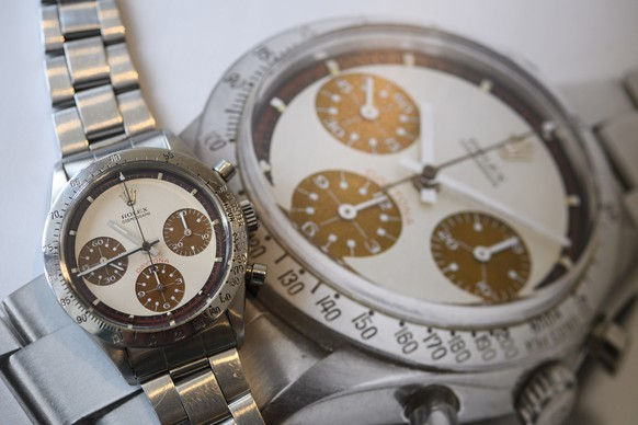 epa06722203 The Rolex Daytona 'Paul Newman' wristwatch with rare 'Tropical' Dial, which is estimated to sell between 208,000 to 416,000 US Dollar, during a preview at the Sotheby's, in Geneva, Switzerland, 09 May 2018. The auction will take place in Geneva on 13 May 2018.  EPA/MARTIAL TREZZINI