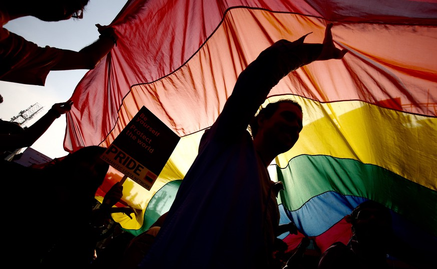 epa07000124 (FILE) - Silhouetted members of the LGBT (Lesbian, Gay, Bisexual and Transgender) community wave a rainbow flag during a pride parade, in Bangalore, India, 20 November 2016 (reissued 06 September 2018). India's Supreme Court ruled on 06 September 2018, that gay sex is no longer a criminal offence. Five Supreme Court judges repealed a colonial-era law (section 377) and legalize gay sex between consenting adults.  EPA/JAGADEESH NV *** Local Caption *** 53126943