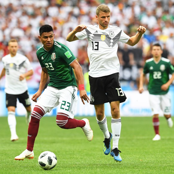 epa06815947 Jesus Gallardo (L) of Mexico in action against Thomas Mueller (R) of Germany during the FIFA World Cup 2018 group F preliminary round soccer match between Germany and Mexico in Moscow, Russia, 17 June 2018.(RESTRICTIONS APPLY: Editorial Use Only, not used in association with any commercial entity - Images must not be used in any form of alert service or push service of any kind including via mobile alert services, downloads to mobile devices or MMS messaging - Images must appear as still images and must not emulate match action video footage - No alteration is made to, and no text or image is superimposed over, any published image which: (a) intentionally obscures or removes a sponsor identification image; or (b) adds or overlays the commercial identification of any third party which is not officially associated with the FIFA World Cup)  EPA/FACUNDO ARRIZABALAGA   EDITORIAL USE ONLY