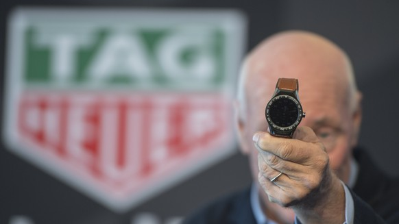 epa05847278 Jean-Claude Biver, CEO of TAG Heuer, presents the smartwatch 'Connected Modular 45', during a press conference of the Watch company TAG Heuer in Brunnen, Switzerland, 14 March 2017. Biver said earlier this year that the second TAG Heuer smartwatch is expected to feature a number of significant improvements over the first-gen model.  EPA/URS FLUEELER