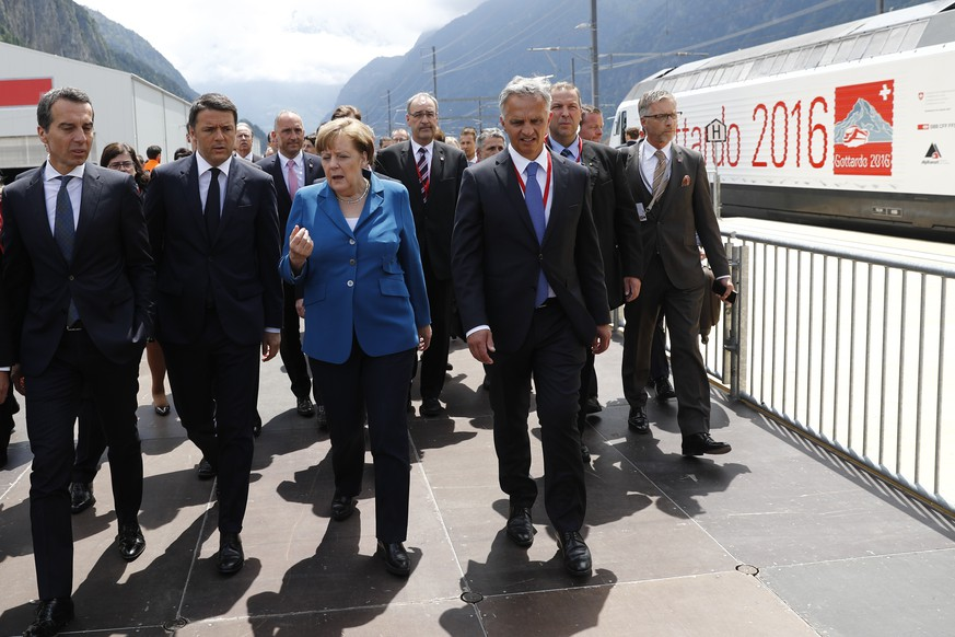 Swiss Federal Councillor Didier Burkhalter, right, walks next to German Chancellor Angela Merkel, Italian Prime Minister Matteo Renzi and Austrian Chancellor Christian Kern, from rihgt to left, on the opening day of the Gotthard rail tunnel, the longest tunnel in the world, at the fairground Rynaecht at the northern portal in Erstfeld, Switzerland, Wednesday, June 1, 2016. The construction of the 57 kilometer long tunnel began in 1999, the breakthrough was in 2010. After the official opening on June 1, the commercial opperation will commence on December 2016. (KEYSTONE/POOL/Peter Klaunzer)