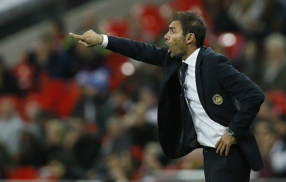 San Marino's manager Pierangelo Manzaroli shouts to his team during the Euro 2016 group E qualifying match between England and San Marino at Wembley stadium in London, Thursday, Oct. 9, 2014. (AP Photo/Kirsty Wigglesworth)