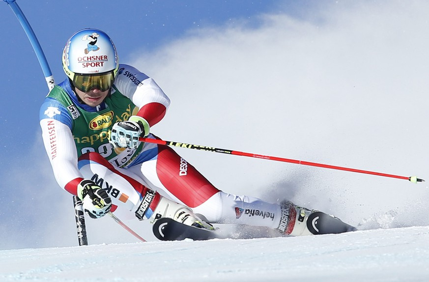 epa05659225 Gino Caviezel of Switzerland in action during the men's Giant Slalom 1st run race at the FIS Alpine Skiing World Cup in Val D'Isere, France, 04 December 2016.  EPA/GUILLAUME HORCAJUELO