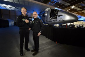 "Solar Impulse's Chief Executive Officer and pilot Andre Borschberg, left, and Solar Impulse's founder, chairman and pilot Bertrand Piccard, right, pose in front of the new experimental aircraft ""Solar Impulse 2"", HB-SIB, during the official presentation at the airbase in Payerne, Switzerland, Wednesday, April 9, 2014. The aircraft HB-SIB is the second solar plane of the Solar Impulse project. The main goal of the project is to circumnavigate the world with an aircraft, with a 72 metres wingspan, powered only by solar energy. (KEYSTONE/Laurent Gillieron)"